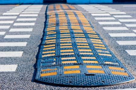 Yellow and Black Speed Bump  on asphalt  Stock Photo - 19661498
