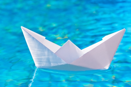 paper boat on the water in the pool photo