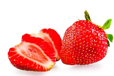 whole and sliced ripe strawberries on a white background photo