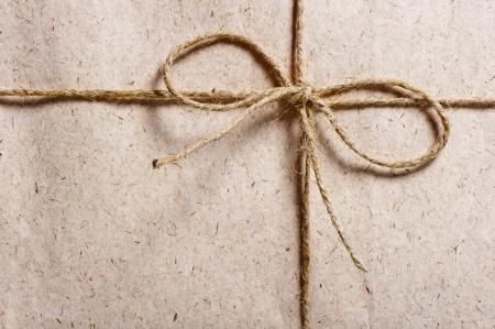 parcel wrapped in brown paper and tied with twine Stockfoto