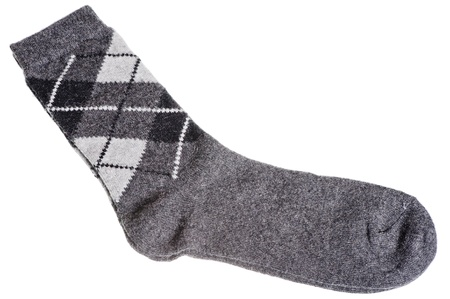 Warm woolen socks with a pattern of diamonds on a white background Stock Photo