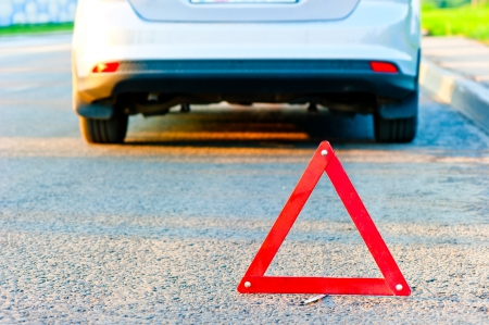 pull over: red warning triangle and a car pull over to the side of the road