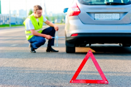 warning triangle and help the mechanic on the road photo