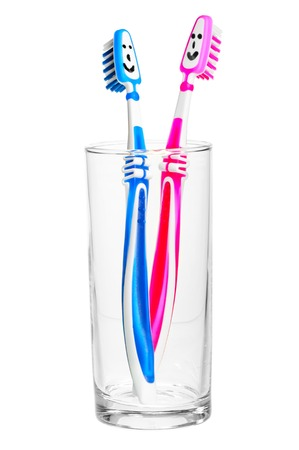 funny emoticons for toothbrushes, standing in a glass Imagens