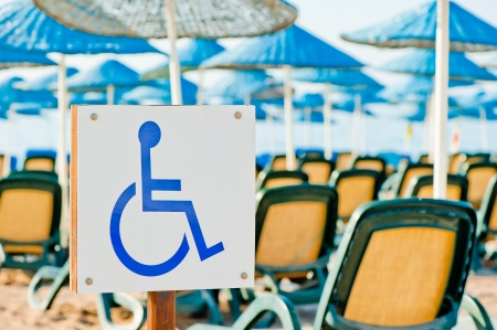sign wheelchair close-up on the beach photo
