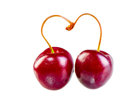 two cherries form the heart