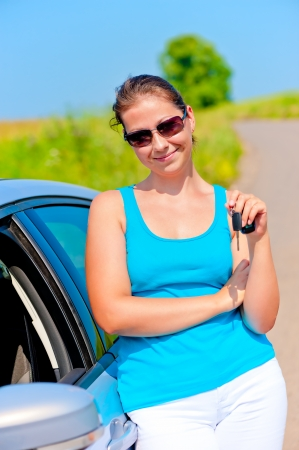 woman with the keys to her new car photo