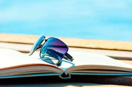 sunglasses lying on an open book