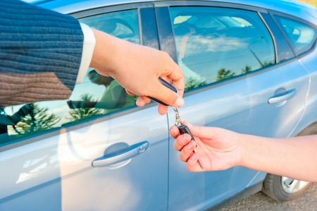 handing the keys to a new car customer photo