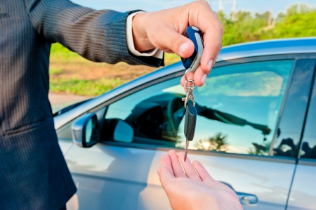 handing over keys of new car buyer photo