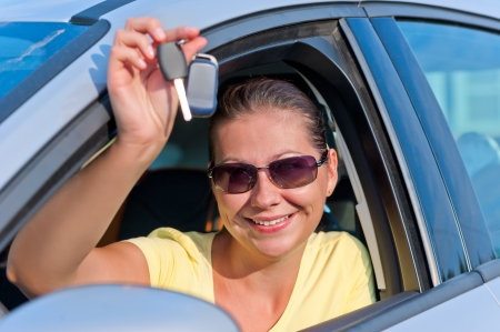 girl shows off the key to the new car photo