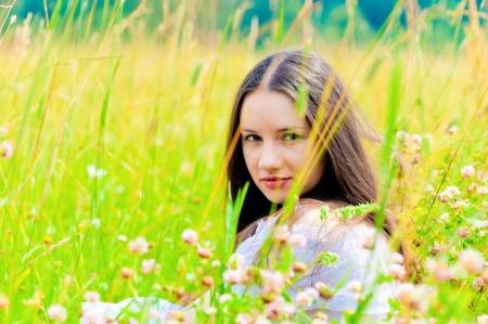 sundress: girl in a white sundress lying on green grass