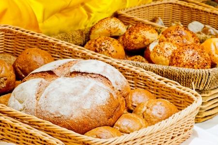wicker basket full of bread and rolls photo