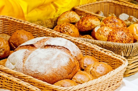wicker basket full of bread and rolls photo