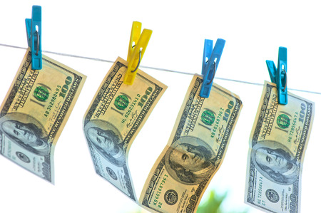 money laundering: dollars are drying on the clothesline in the sun