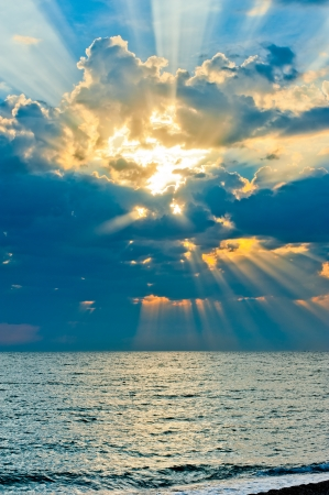 Vertical shot of a beautiful sky with sun rays photo