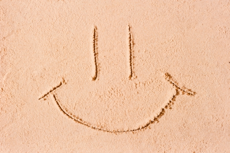 smiley face on the wet sand photo