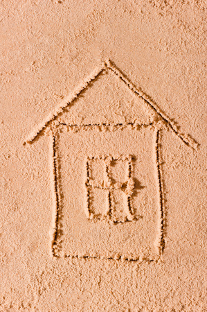 dacha: Children drawing in the sand on the beach Stock Photo