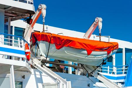 lifeboat hanging on a big ship photo