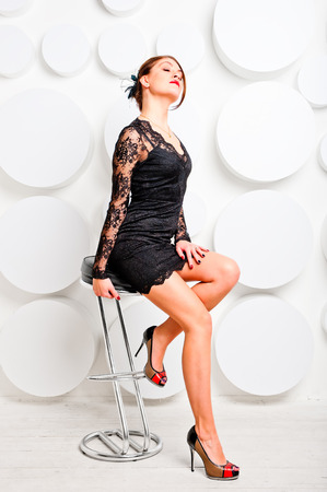 languid girl in sexy dress on a chair photo