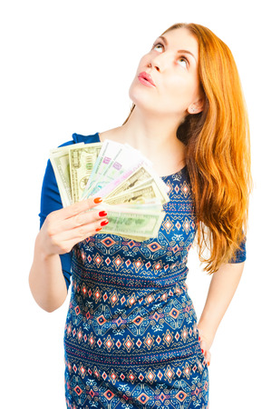 thinks: rich girl thinks to spend money Stock Photo