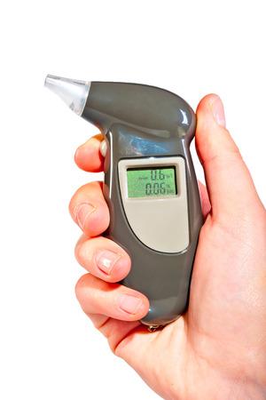Breathalyzer in a female hand showing drunkenness Standard-Bild