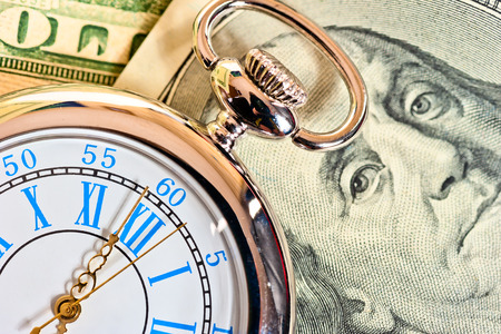 12 oclock: antique pocket watch on the dollar Stock Photo