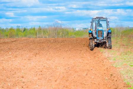 tractor plowed field in spring photo