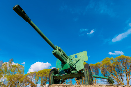 monument of military weapons against the sky photo