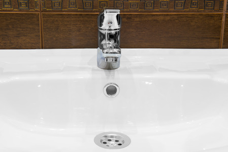 sink, and shiny faucet in the bathroom photo