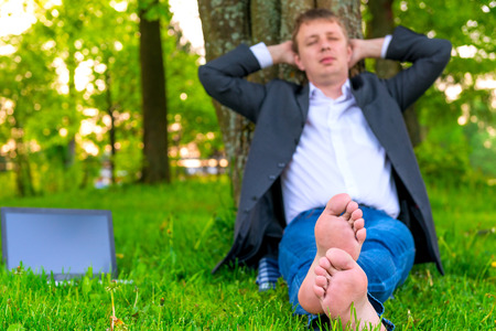 businessman pleasant stay in the park photo