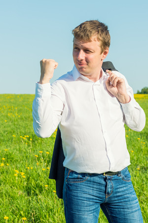 expresses: wealthy businessman expresses his feelings with gestures Stock Photo
