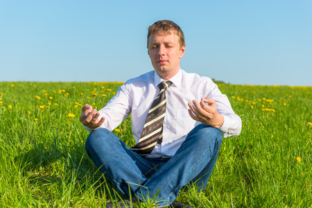 businessman relaxing relieves stress in the field photo