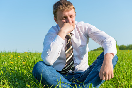 pensive businessman thinking about work in the field photo