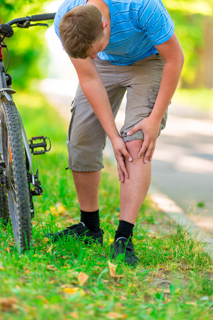 cyclist and sports knee injury photo
