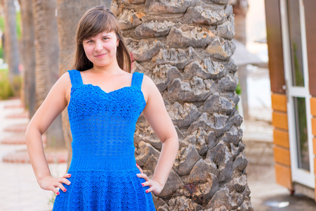 20 years old: happy beautiful girl 20 years old in a blue sundress Stock Photo