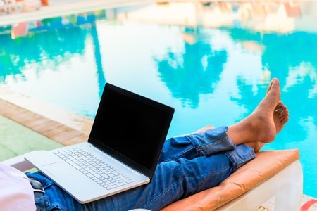 bare feet of a businessman on vacation pool