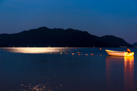 moonwalk: fishing boat in the night a calm sea