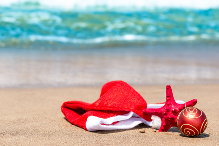 'yule tide': Christmas attributes and starfish on the beach