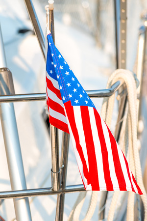 waving flag of the United States on a yacht