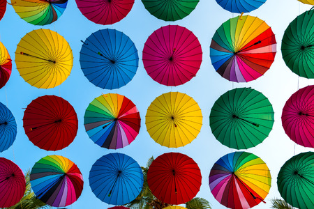 disclosed: colorful umbrellas disclosed rows on sky background Stock Photo