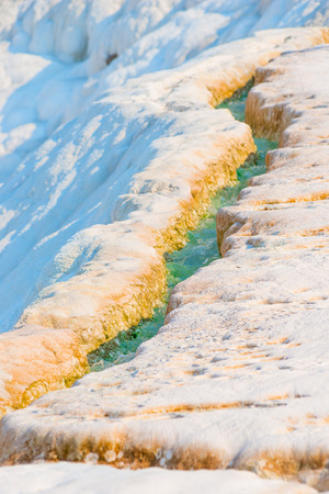 rivulet: rivulet with turquoise water on the mountain in Pamukkale Stock Photo