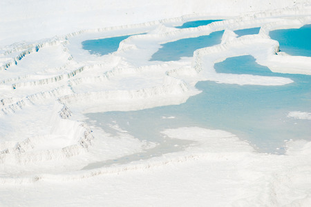 beautiful turquoise water on snowy mountain in Pamukkale