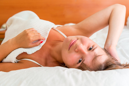 get up: beautiful girl awoke and no hurry to get up Stock Photo