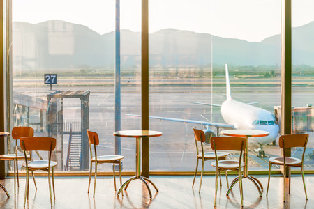 bar stool: empty cafe tables in the airport and on the plane view