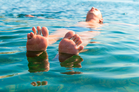 splayed: feet with splayed fingers lying on the water man