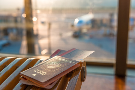 airport window: passports and tickets on a background of an airplane Stock Photo