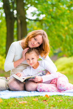 portrait of mother and daughter in the summer park photo