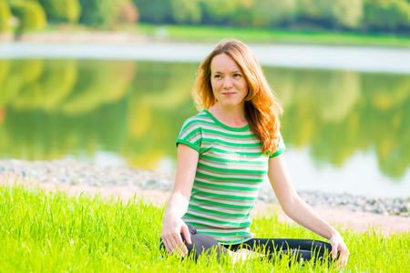 non urban 1: beautiful slender girl is preparing for yoga on the nature Stock Photo