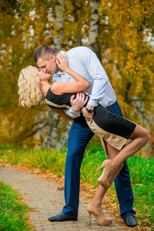 passionately: young couple passionately kissing in autumn park Stock Photo